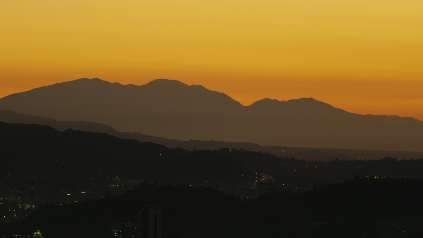 Aerial morning view building and street lights central Los Angeles with sunrise over San Gabriel mountains California USA | Shutterstock HD Video #1032006305