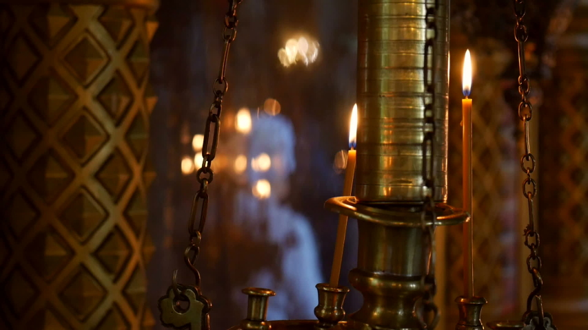 Burning candles in an Orthodox Church. Soft candlelight.   Shutterstock HD Video #1032022955