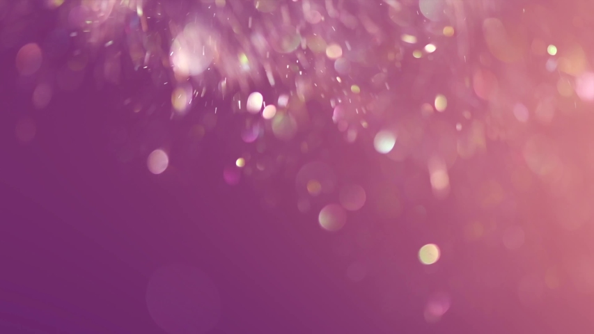 Abstract particles floating, motion, random flickering. Colorful Dust sparkles on pink background. Real Glittering sparkling particles Bokeh. Holiday backdrop. Slow motion 4K UHD video   Shutterstock HD Video #1032042095