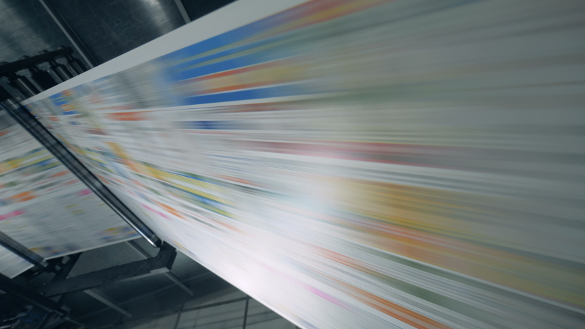 Coloured paper is rapidly moving through the rolling press. Fake news concept. | Shutterstock HD Video #1032114695