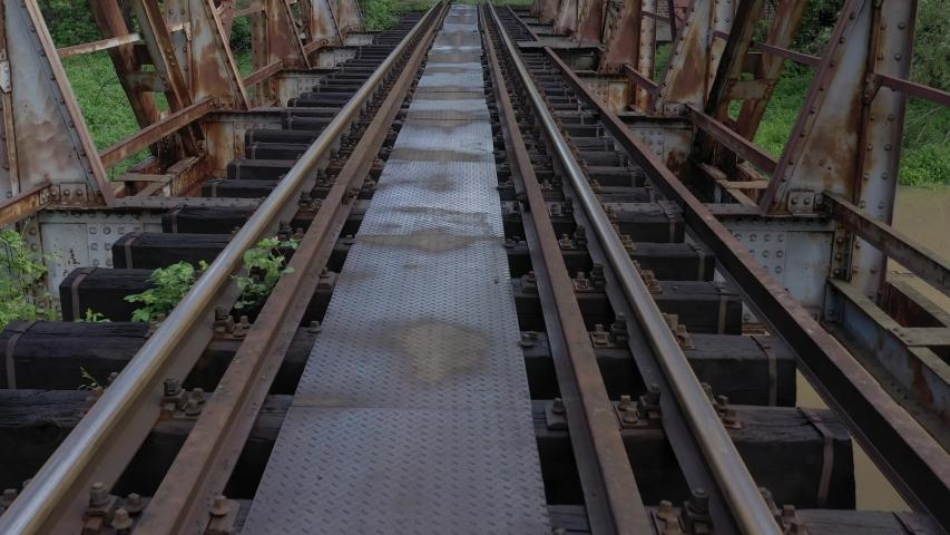 Rusty single railway track and bridge 4K aerial video | Shutterstock HD Video #1032181385