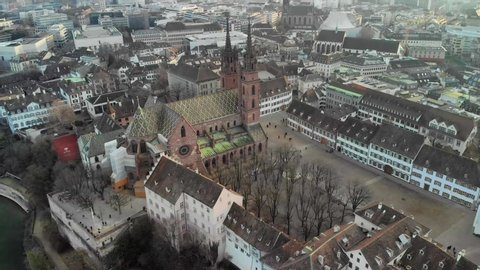 Famous Gothic-style Basel Minster, Cathedral in Basel, Switzerland at winter Aerial view of the Famous Gothic-style Basel Minster, Cathedral in Basel, Switzerland at winter sunset