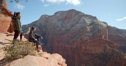 Hikers Sitting on Edge of Canyon, Couple Hiking Zion National Park