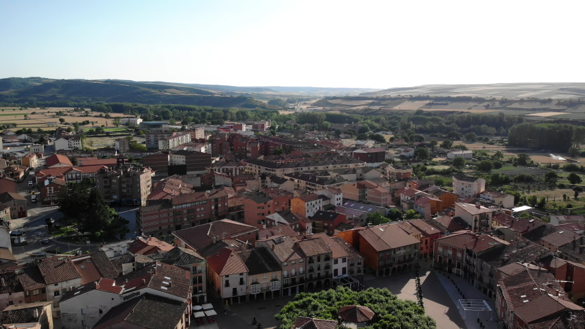 Aerial view of Belorado, Spanish village in the province of Burgos, Castile-Leon, Spain along Camino de Santiago or Way of St James. City landscape with church and square seen from drone flying in sky | Shutterstock HD Video #1032518345