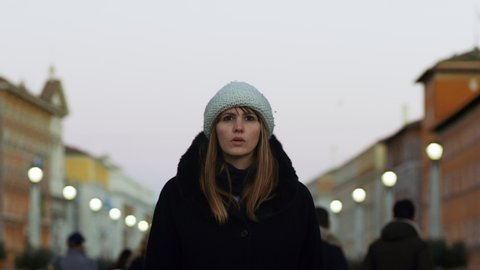 Close up portrait of attractive, fashionable, and serious blond  woman confidently walking in St Peter's Square in the Vatican