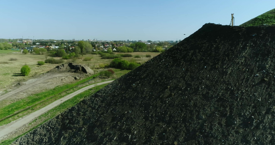 Aerial view of the garbage dump hill. | Shutterstock HD Video #1032618305