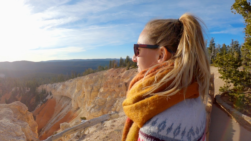 Young woman travels Bryce Canyon national park in Utah, United States, people travel explore nature. Girl hiking in red rock formations | Shutterstock HD Video #1032654935