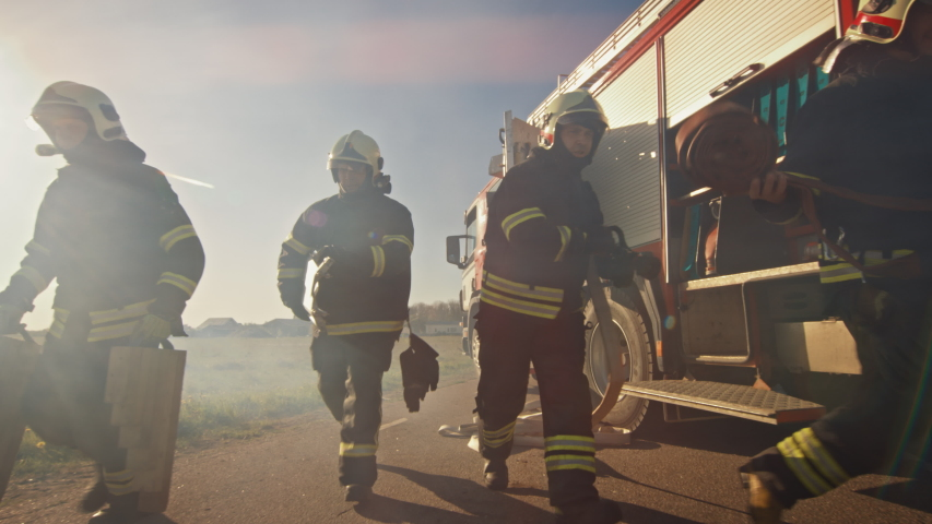 Rescue Team of Firefighters Arrive on the Car Crash Traffic Accident Scene on their Fire Engine. Firemen Grab their Equipment, Prepare Fire Hoses and Gear from Fire Truck. In Slow Motion | Shutterstock HD Video #1032836105