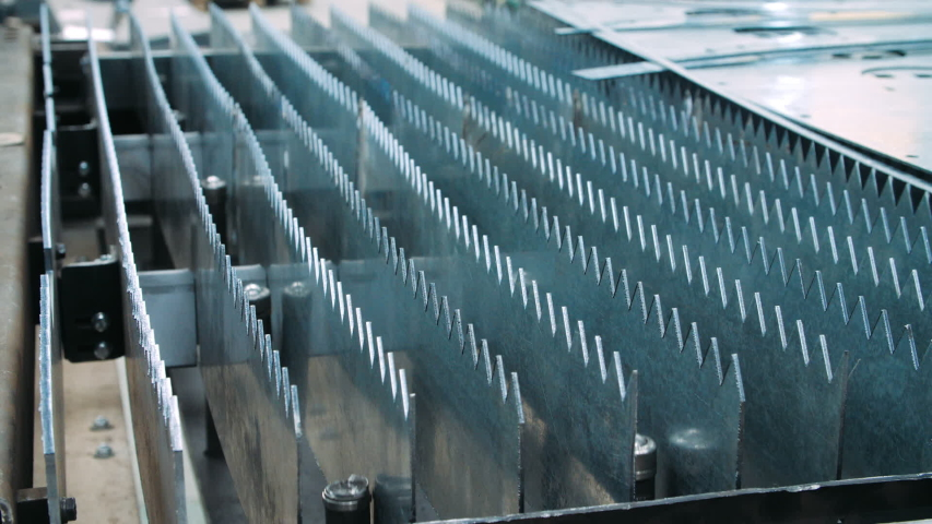 Industrial equipment for metalworking with sharp metal workpieces. Row of metal workpieces with pointed edges. Parts of machine for laser cutting. Heat-resistant alloy as part of laser cutting machine | Shutterstock HD Video #1032871295