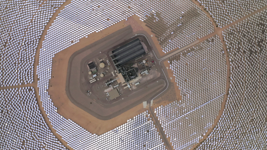 Drone rotates on its axis showing view on circles of solar panels and power station in the middle. Aerial 4K   Shutterstock HD Video #1032933125