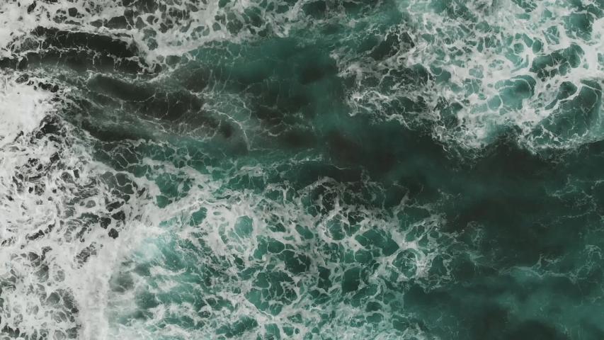 Aerial view of the Atlantic coast, aquamarine color of the waves falling on the beach of volcanic origin, Tenerife, Spain #1033023065