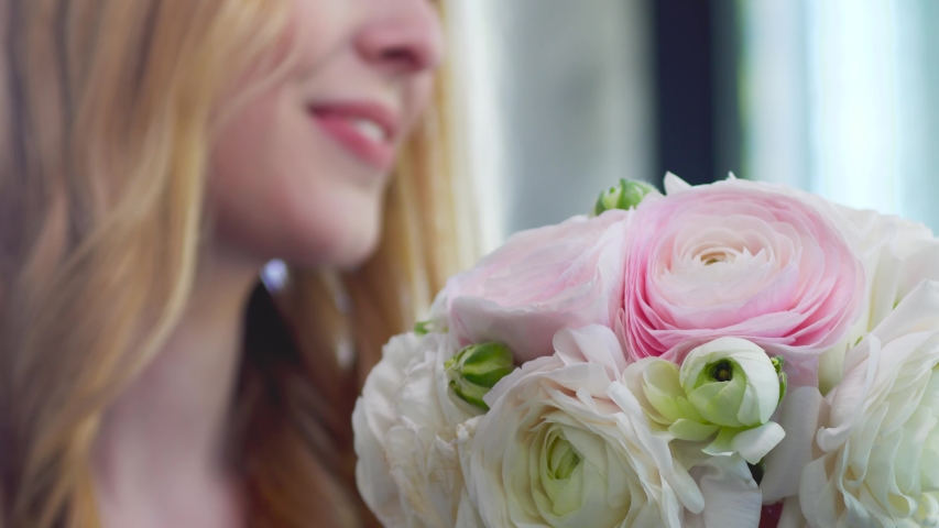 girl is happy to receive fresh flowers. female smile and pink and white roses #1033053485