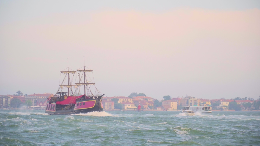 Old fashioned wooden yacht sailing in Grand Canal in Venice | Shutterstock HD Video #1033145735