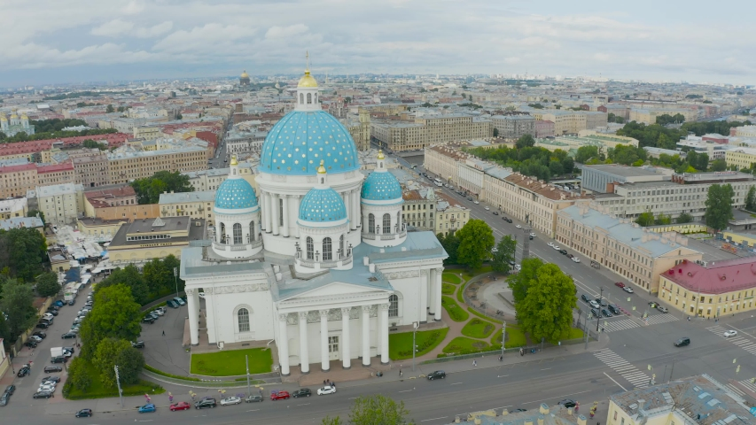 The famous Trinity Cathedral with blue domes and gilded stars, view of the historic part of the city of Staint-Petersburg, typical houses around | Shutterstock HD Video #1033188125