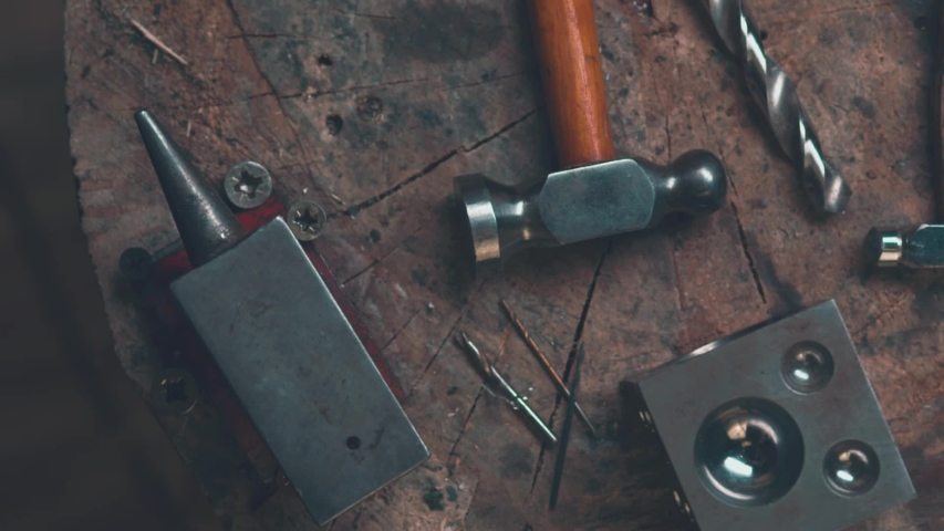 Master goldsmith working with gold-shaping of the object by hammering   Shutterstock HD Video #1033197005