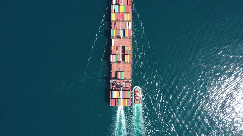 Aerial view of Cargo ship. Large container ship at sea - Aerial top down.  | Shutterstock HD Video #1033254665