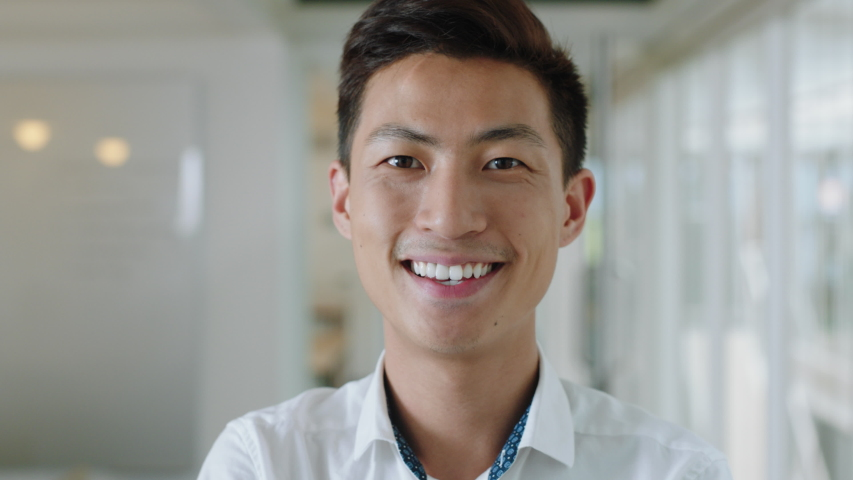 Portrait young asian businessman smiling enjoying successful career proud entrepreneur in office workplace testimonial 4k footage | Shutterstock HD Video #1033257185