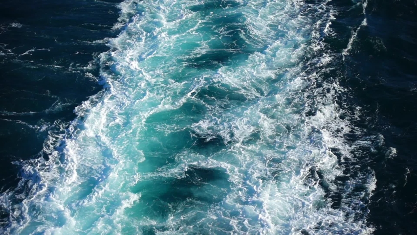 Slow motion video of waves splashing by passenger ship cruising the deep blue Aegean sea | Shutterstock HD Video #1033261745