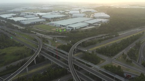 Motorways m4 and m7 light horse interchange in sydney western suburbs –  aerial panning over multi-lane highways with traffic