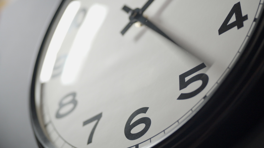 Closeup of White Clock Face in timelapse in daytime of office dark grey wall  | Shutterstock HD Video #1033389065