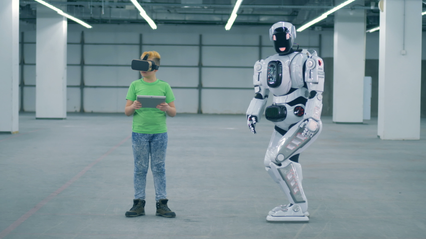 One child uses VR equipment while working with android, close up. | Shutterstock HD Video #1033569725
