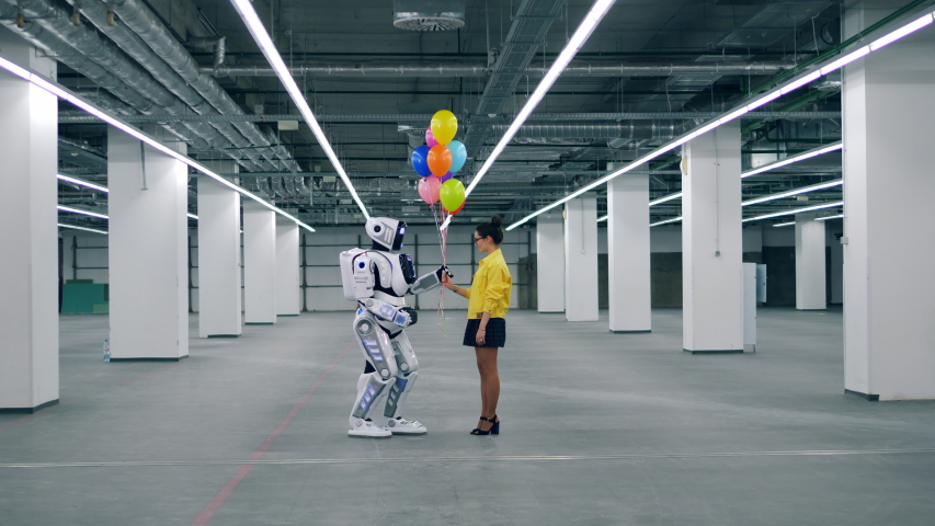 Human-like cyborg and a woman are holding balloons | Shutterstock HD Video #1033599995