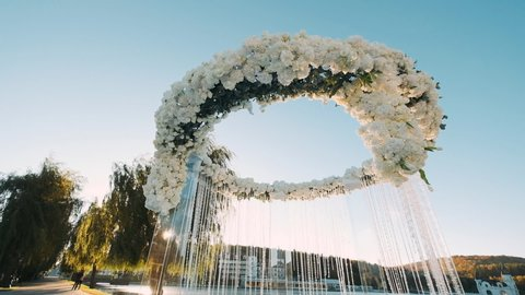 Concept Of Wedding Decor, Street Decoration, Wedding Arch Is Decorated With Flowers. Wedding Arc In The Form Of Circle.