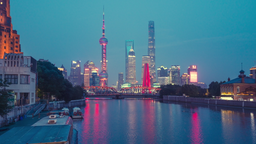 time lapse of sunset, Shanghai skyline and Waibaidu bridge, China