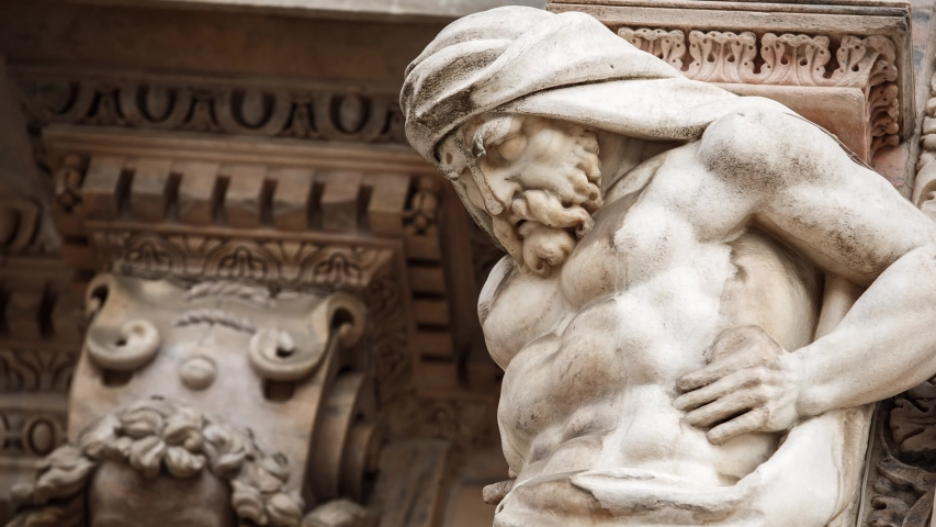 Beautiful Duomo di Milano in close up.White marble stone sculptures and statues in exterior design of ancient catholic church in center of Milan city in Italy.Gothic architecture style in details | Shutterstock HD Video #1033712945