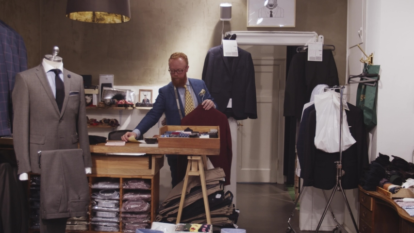 Copenhagen, Denmark - 06 03 2019: Tailor working in his tailoring studio shop. | Shutterstock HD Video #1033781255