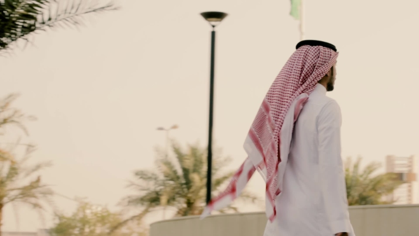 Saudi man walking in a beautiful place | Shutterstock HD Video #1033875155