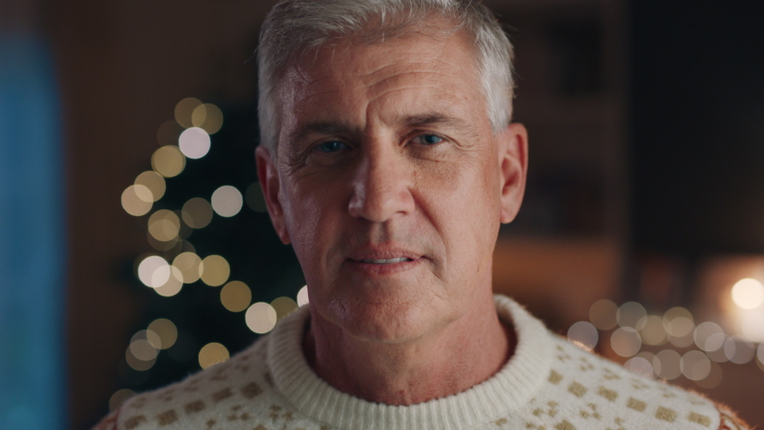 Portrait mature man celebrating christmas at home looking happy festive holiday celebration at home 4k | Shutterstock HD Video #1033939715