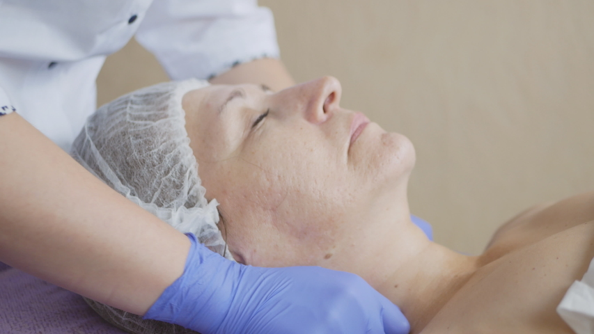Beauty treatments in the spa salon. face cleaning. cosmetic face massage.   Shutterstock HD Video #1033971245
