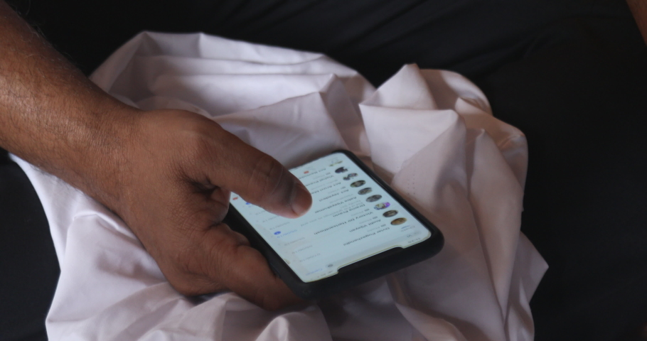 Male Model hands with cell phone Hyderabad India 10th July 2019 | Shutterstock HD Video #1034058875