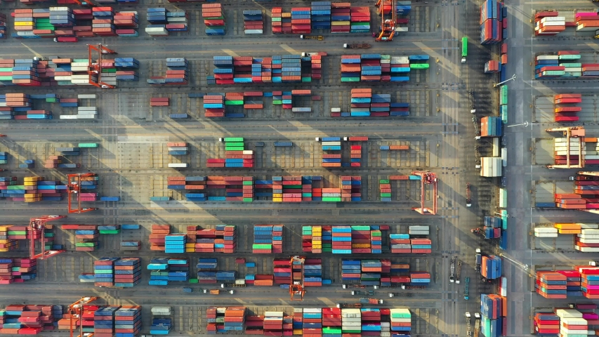 Aerial view. Container ship in pier with crane bridge carries out export and import business in the open sea. Logistics and transportation  | Shutterstock HD Video #1034132405