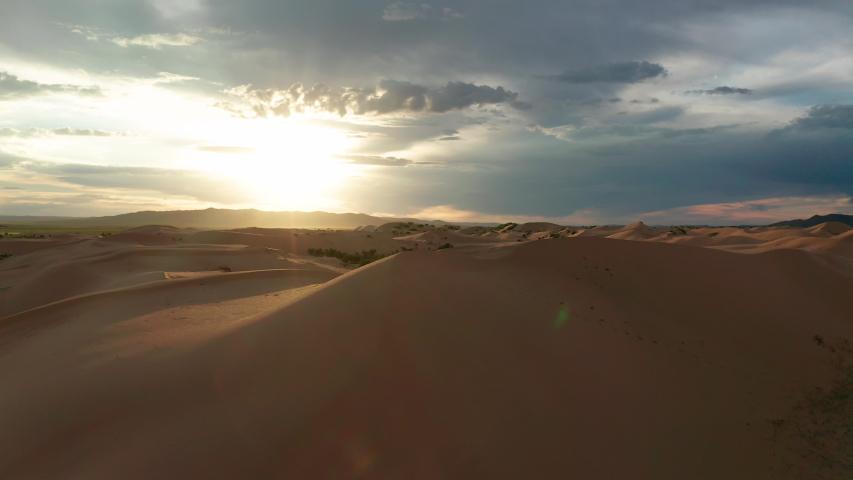 Sunset over the sand dunes in the desert | Shutterstock HD Video #1034194025
