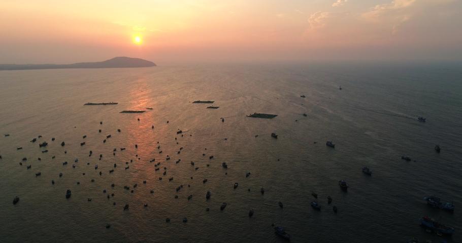 Top view, aerial view sunrise. Royalty high quality free stock footage of Mui Ne fishing harbour or fishing village. Mui Ne fishing harbor is a popular tourist destination. Phan Thiet city, Vietnam
