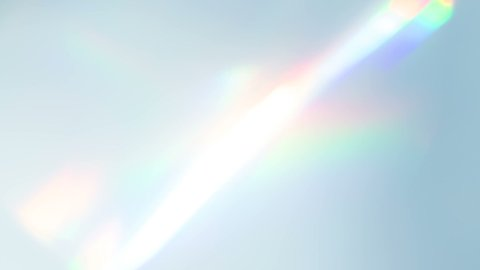 Diamond Creates a Bright Highlight. Loop. The light passes through the facets of a slowly rotating diamond and creates repetitive sparkling highlights and rainbow colors
