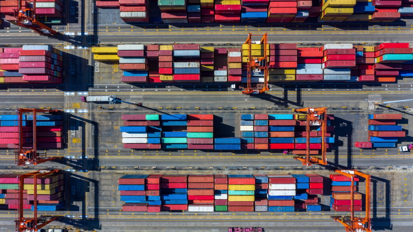 Aerial view shipping container terminal, Aerial view containers in the industrial port with lot's of different colors.  | Shutterstock HD Video #1034376545