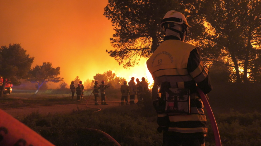 Night, wildfire, group of firefighters watch fire burning. Chateauneuf, France June 2016 | Shutterstock HD Video #1034422265