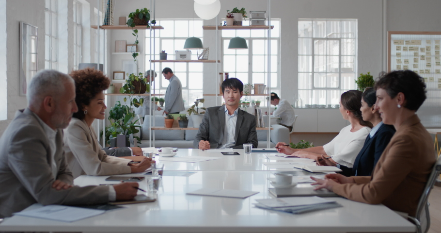 Asian businessman executive meeting corporate leaders discussing development ideas with shareholders brainstorming in office boardroom   Shutterstock HD Video #1034536085