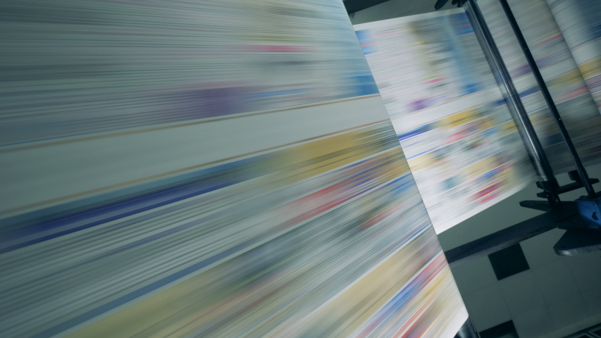 Long newspaper pages moving on a conveyor at a printing office. | Shutterstock HD Video #1034551595