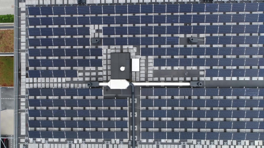 Aerial top down view of just finished modern neighborhood apartment building with solar panels on flat roof providing the residential part with renewable energy from the sun 4k high resolution | Shutterstock HD Video #1034596085