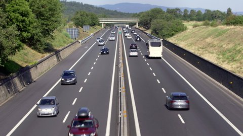 Motorway in Tuscany, August 2019, Regular traffic on Sunday morning with cars traveling in both north and south directions for the summer exodus holiday. Trucks don't travel, just cars and buses