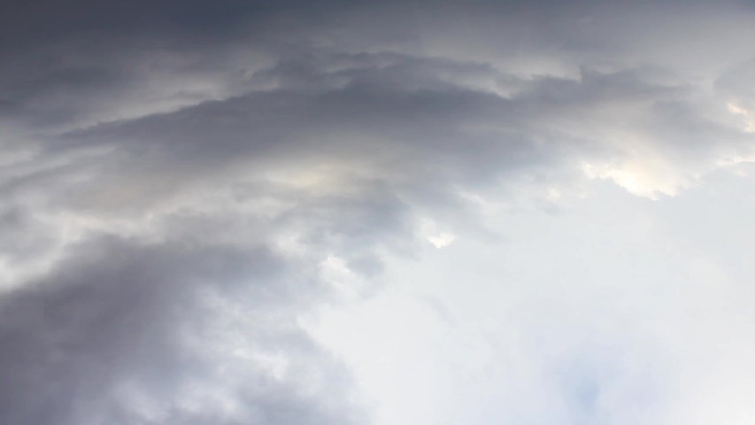 Rainy time lapse dark clouds in horizon, aerial view fluffy, puffy forming cloudscape in panorama. Beautiful angry big mass rotation, rolling. /UHD.