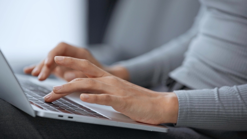 Cropped view of woman using laptop | Shutterstock HD Video #1034804945