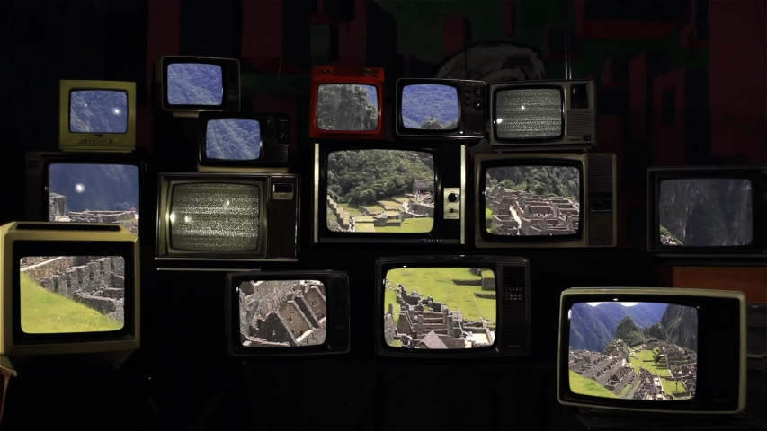View Of Machu Picchu, the Lost Inca City in the Andes, Seen on Retro TVs.  | Shutterstock HD Video #1034863265