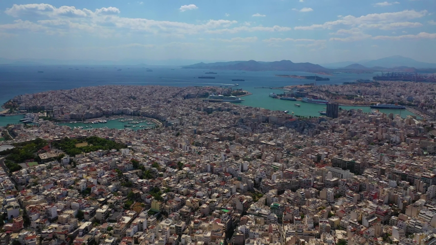 Aerial drone bird's eye view video of famous port of Piraeus one of the largest in Europe, Attica, Greece #1034950595