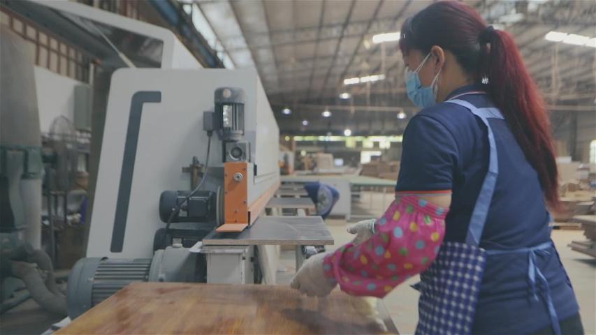Edgebander machine. People work on edgebanding machine. Single sided automatic edge bander on factory. | Shutterstock HD Video #1035117215
