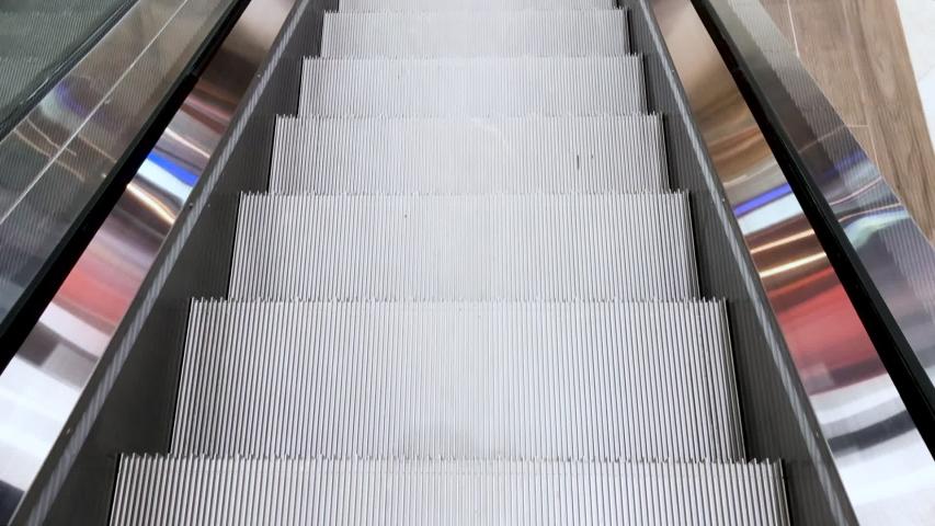 Sliding down the escalator. Meditative urban video. | Shutterstock HD Video #1035151295